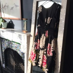 Black cocktail dress with flowers